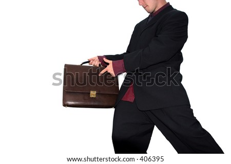 Picture of a businessman pointing at a briefcase, isolated on white
