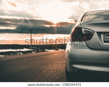 Picture of a car at sunset.