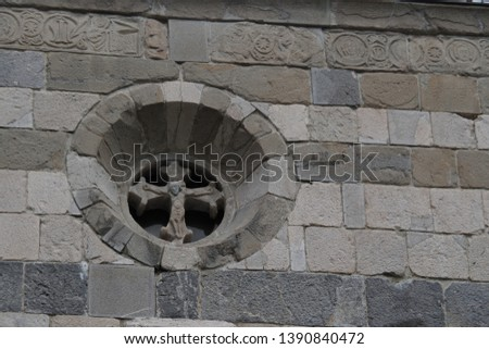 Picture of a church window with Jesus Christ on the cross with room for text on the wall.