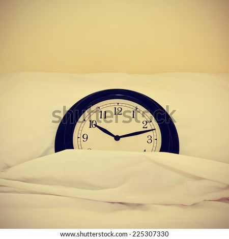 picture of a clock inside a bed, with a retro effect