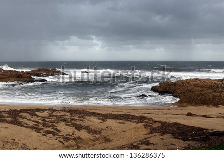 Picture of a Cloudburst Over Sea at Beachfront - stock photo