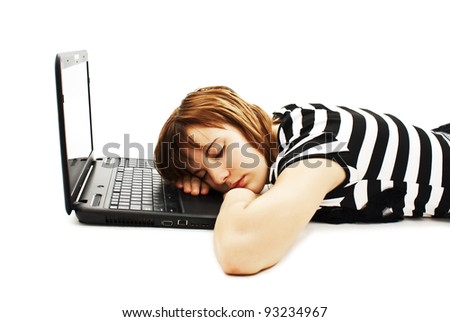 Picture of a cute teenage girl sleeping on her laptop computer. Isolated on white background