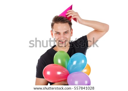 Picture of a cute young guy holding colorful balloons
