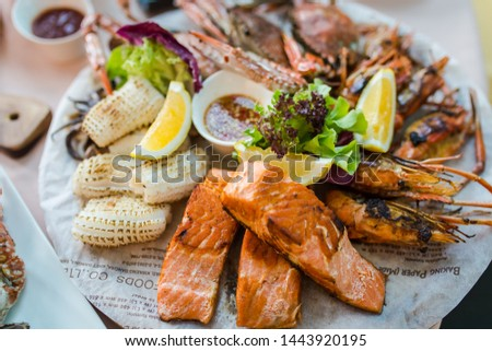 Picture of A delicious seafood at luxury restaurant. A plate of fresh seafood with shrimps, prawns, crabs, salmon, squid and mussels