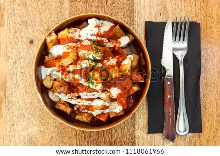 Picture of a dish of Papas bravas, made with potatoes, peppers ad garlic. Typical meal from Tarifa, Andalusia, Spain.