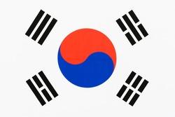 Picture of a fabric flag of South Korea aka Taegukgi full frame with the Taegeuk and trigrams