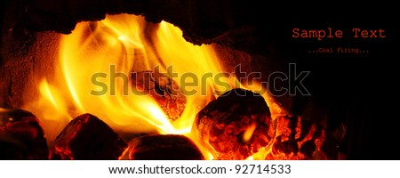 Picture of a fire. Burning coal in fireplace. Image with space for your text.