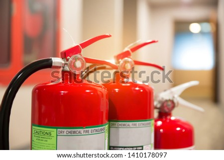 Picture of a fire extinguisher with Fire hose Prepare for fire safety and prevention.