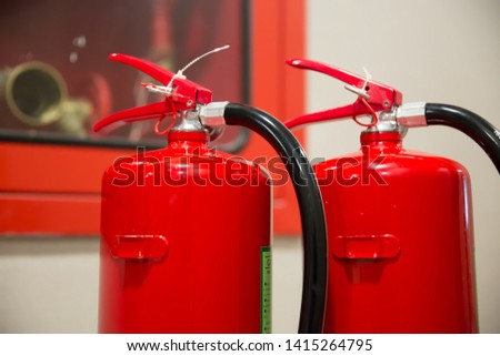 Picture of a fire extinguishers with Fire hose Prepare for fire safety and prevention.
