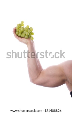Picture of a fit, muscular arm holding grapes, on a white, isolated background