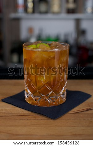 Picture of a fresh cocktail on a bar desk