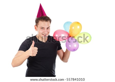 Picture of a funny young man holding colorful balloons showing thumbs up