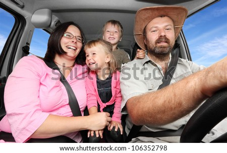Picture of a happy family riding on a holiday.