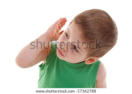 picture of a kid looking to a side with hand on his ear, over white