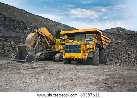 picture of a large mining trucks and excavators