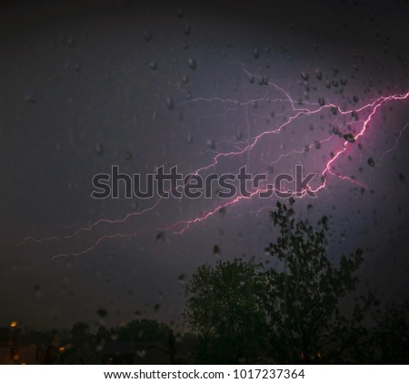 Picture of a lightning bolt on a stormy night in Kentucky ;looking out of sliding glass door-Natures photography
