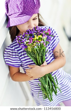 Picture of a little girl with flowers in their hands