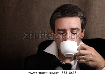 Picture of a man drinking coffee after celebration