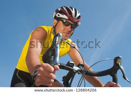 Picture of a man riding a racing bicycle