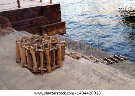 Picture of a marine ladder used to usually embark onboard boats while they are at sea, also called pilot ladder. Marine background.