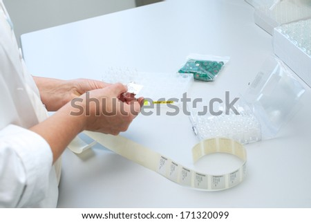 Picture of a person working in a lab