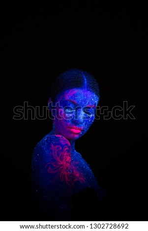 Picture of a pink jellyfish on the shoulder and face. Blue girl alien  sleeps. Tilted her head to the shoulder