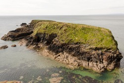 Picture of a small rocky Brown Island in Annestown Cove,County Waterford,Ireland.