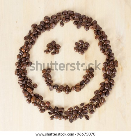 Picture of a smiley face made of coffee beans