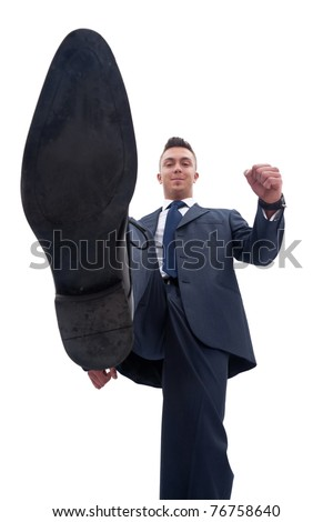 picture of a smiling business man stepping on something, over white - stock photo