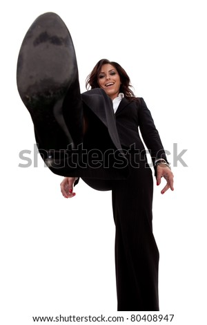 picture of a smiling business woman stepping on something, over white
