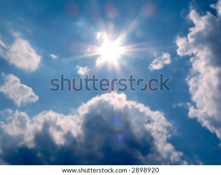 picture of a sunny blue sky with the focus on the suns rays for a heavenly appearance