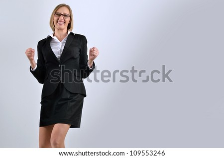 Picture of a very happy businesswoman winning