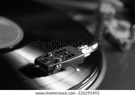 Picture of a vinyl record playing in black and white