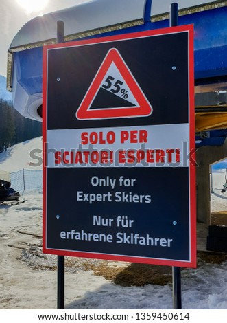 Picture of a warning sign on a ski slope only for expert skiers in Cortina d'Ampezzo, Dolomites, Italy. #1359450614