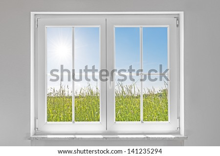 picture of a white wall with white closed window indoor and outside green meadow with sun and blue sky
