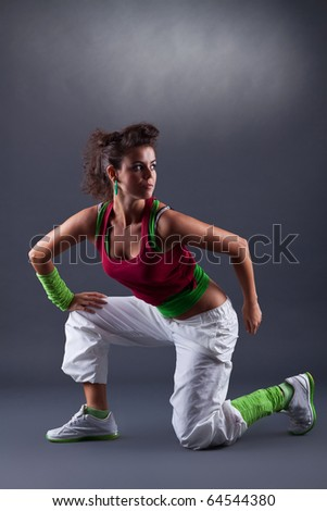 picture of a woman dancer taking a moment to rest
