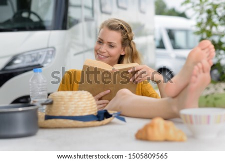picture of a woman outside the camping car