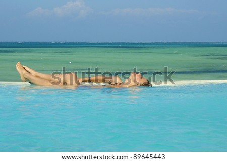 Picture of a woman sunbathing in a swimming-pool