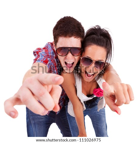 picture of a young couple pointing at you and screaming