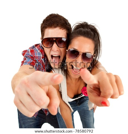 picture of a young couple pointing to you and screaming