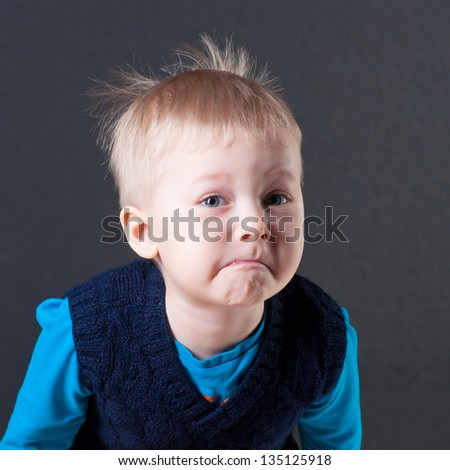 picture of a young kid over dark background