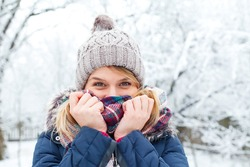 Picture of a young woman feeling cold on wintertime