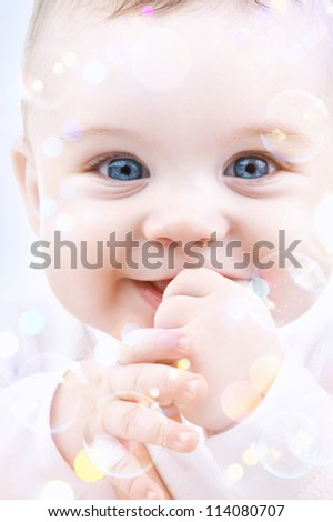 picture of adorable baby with soap bubbles