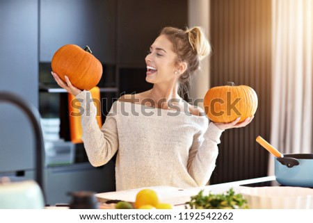 Picture of adult woman in the kitchen preparing pumpkin dishes for Halloween