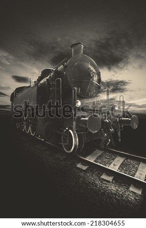 Picture of an ancient locomotive with brown tones