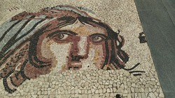Picture of an ancient woman made of mosaics on the floor
