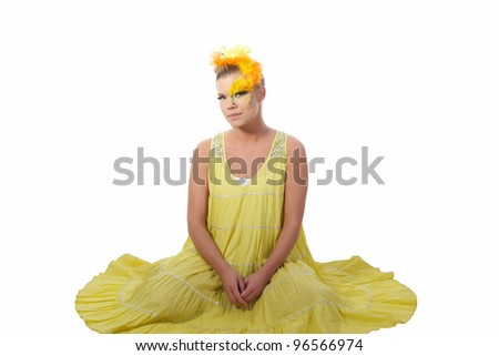 Picture of an easter girl dressed in yellow, with eggs in her hair, on a white, isolated background