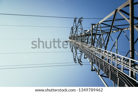 Picture of an electrical tower or pylon, blue sky in the background. Power grid or smart grid.  #1349789462