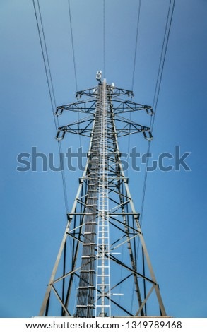 Picture of an electrical tower or pylon, blue sky in the background. Power grid or smart grid.  #1349789468