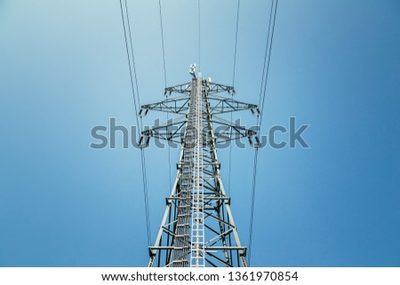 Picture of an electrical tower or pylon, blue sky in the background. Power grid or smart grid.  #1361970854
